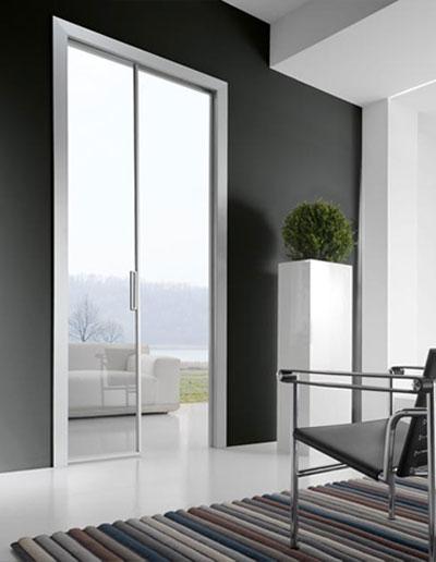 <strong>QUASAR L</strong> | Interior Sliding | Silver Anodized Aluminium | Transparent Glass | Linear